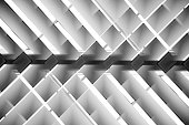 Black and white close-up photo of brightly lit lath ceiling