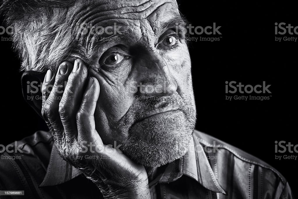 Black and white close-up portrait of a pensive male senior royalty-free stock photo
