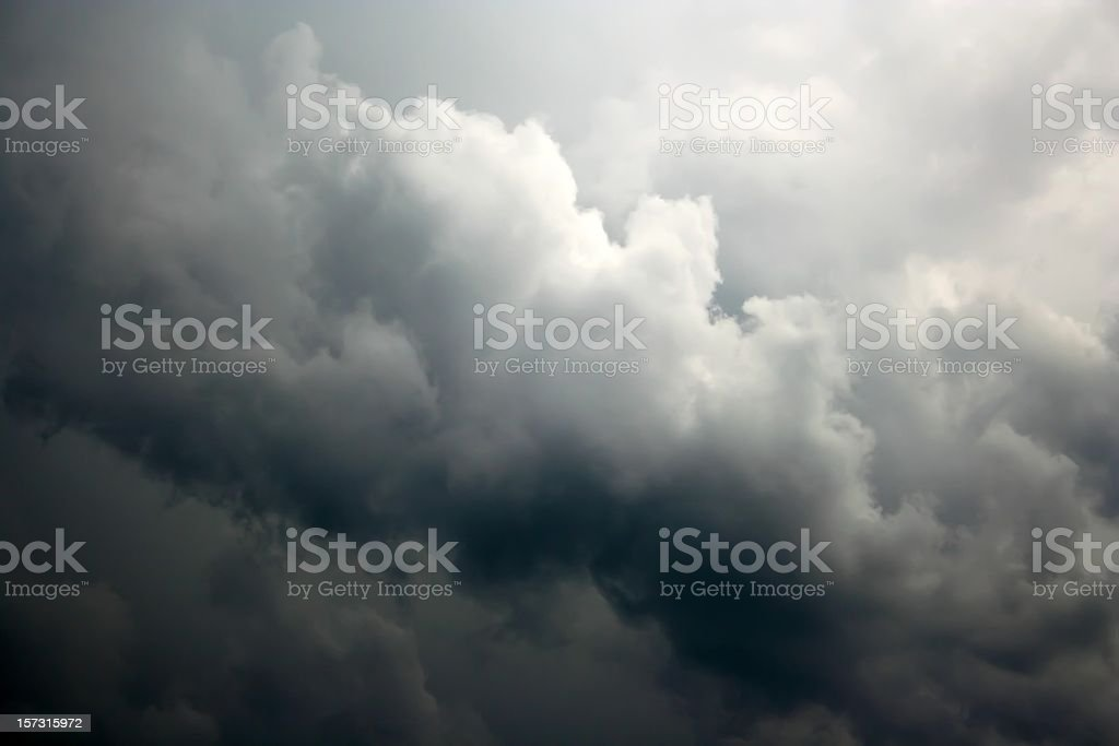 Black and white clouds forming a storm seen from above stock photo