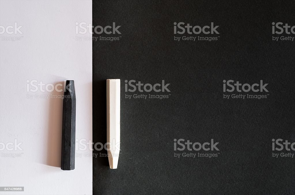 black and white crayons on alternate background same color stock photo