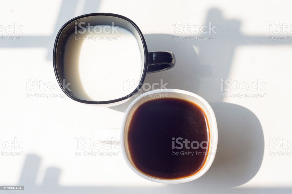 black and white cup of milk, coffee on natural background, top view stock photo