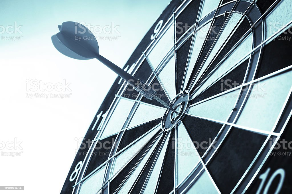 Black and white dart table with dart in bullseye stock photo
