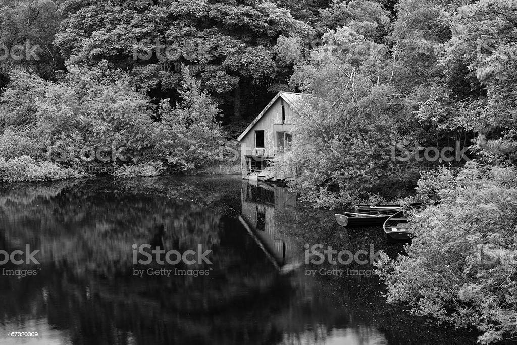 Black and white derelict boathouse with rowing boats landscape royalty-free stock photo