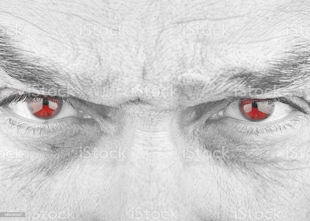 Black and White Evil Stare with Isolated Red Eyes royalty-free stock photo