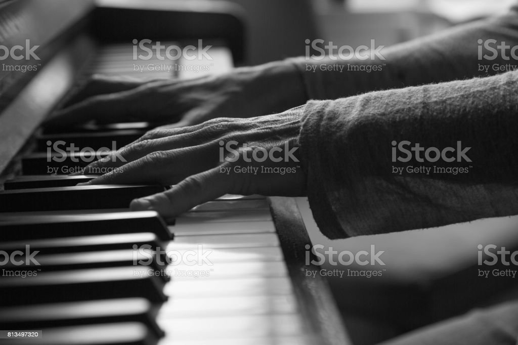 Black and white female playing piano stock photo