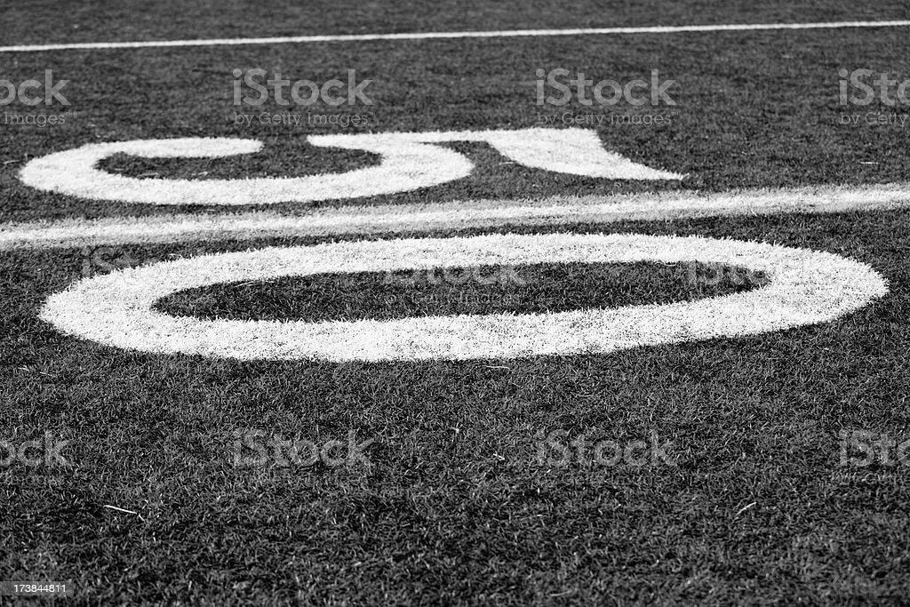 Black and white fifty yard line football field royalty-free stock photo
