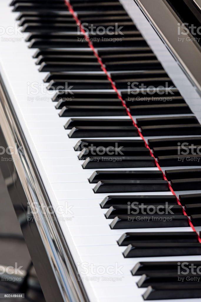 black and white grand piano keys closeup stock photo