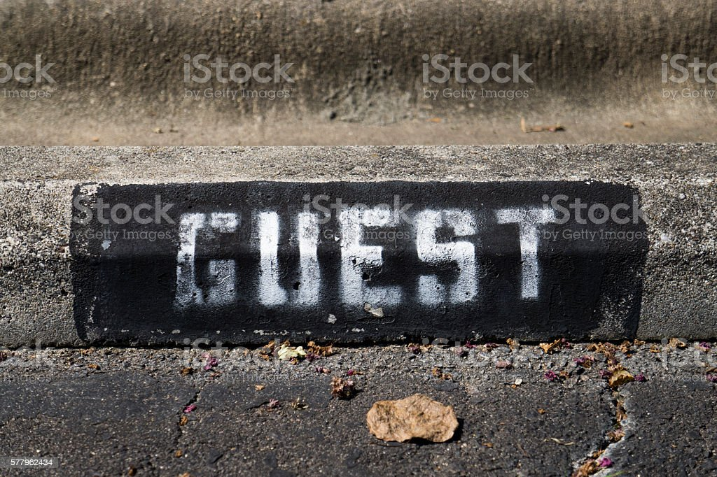 Black and White Guest Posted Sign stock photo