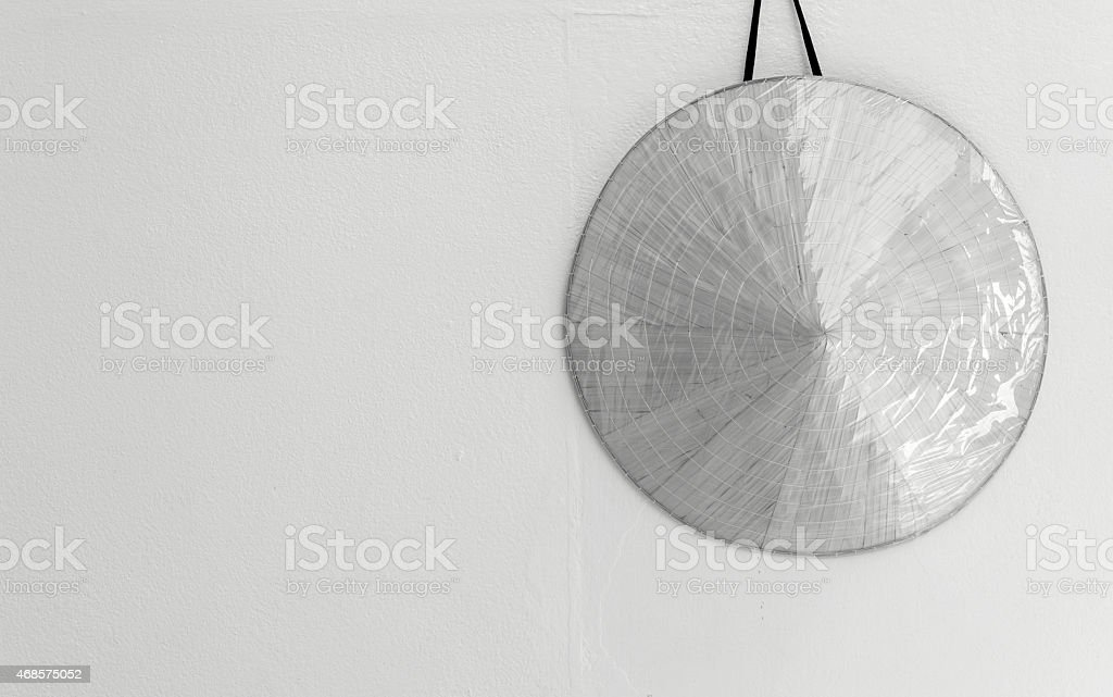 Black and white hat on the wall royalty-free stock photo