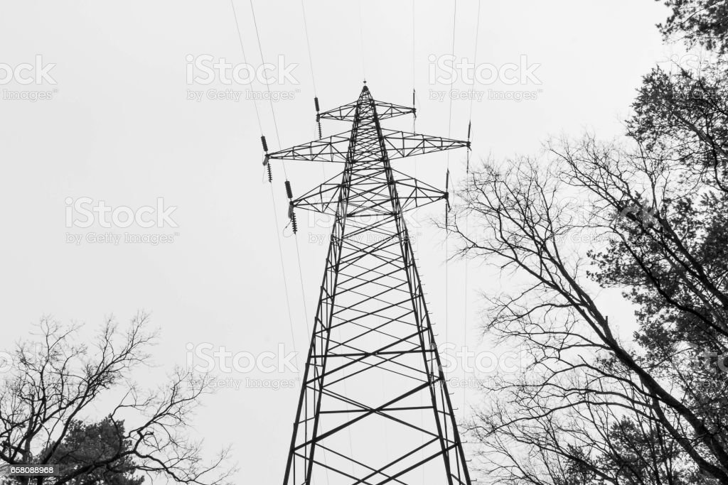 Black and white. High pole mains. Electricity. High voltage network. stock photo