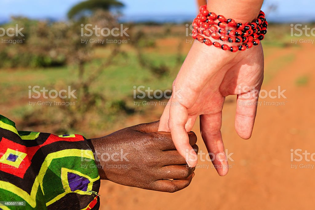 Black and white holding hands stock photo