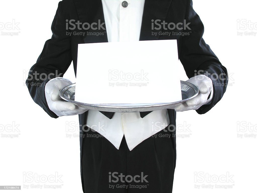Black and white image of a butler holding a blank paper stock photo