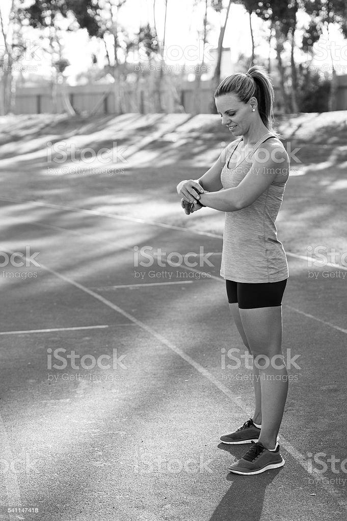 Black and white image of a female athlete stock photo
