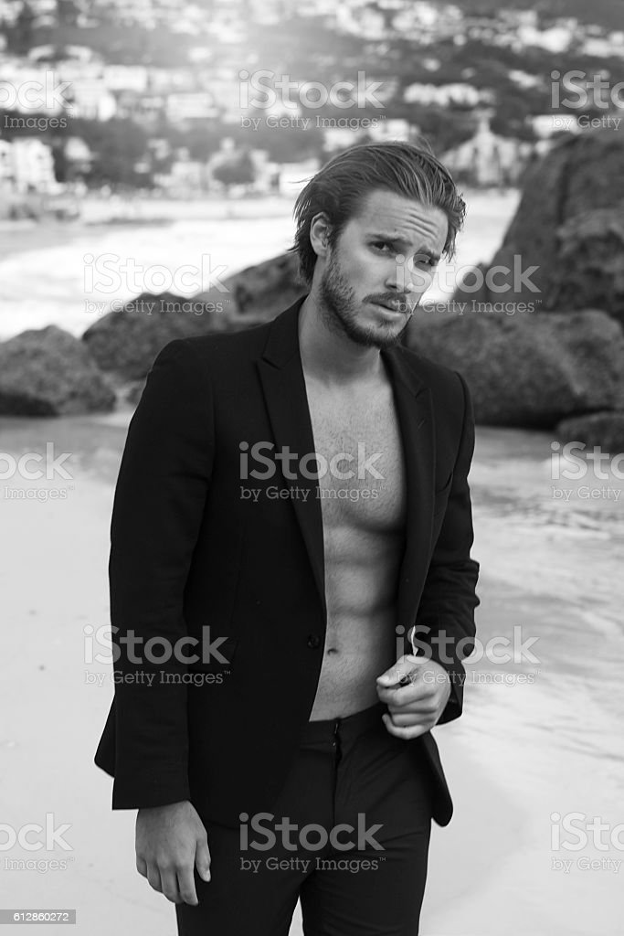 black and white image of a handsome fit man stock photo