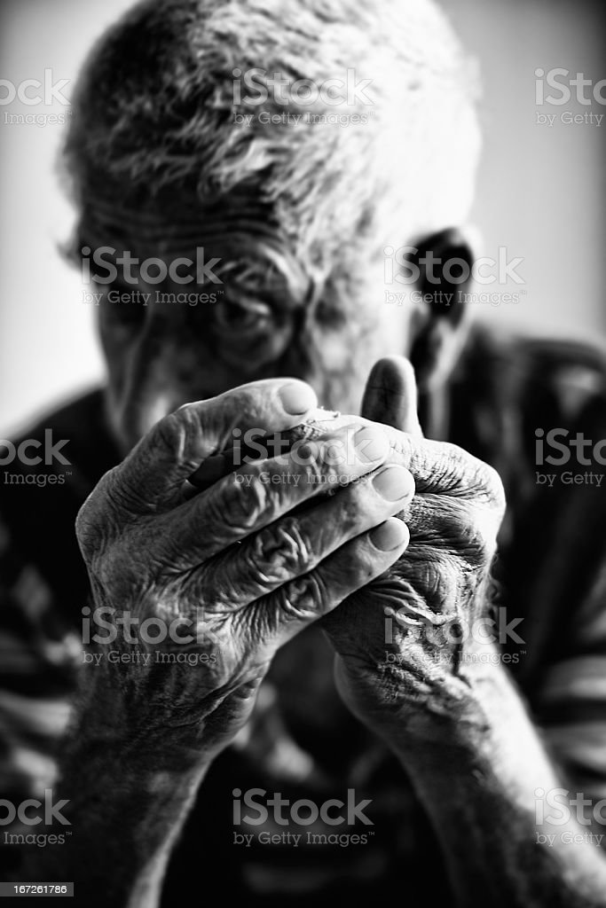 Black and white image of a senior man reacting to bad news royalty-free stock photo
