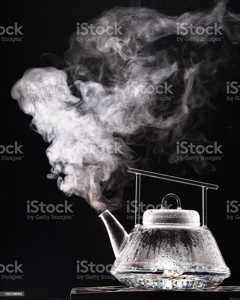A black and white image of a tea pot stock photo