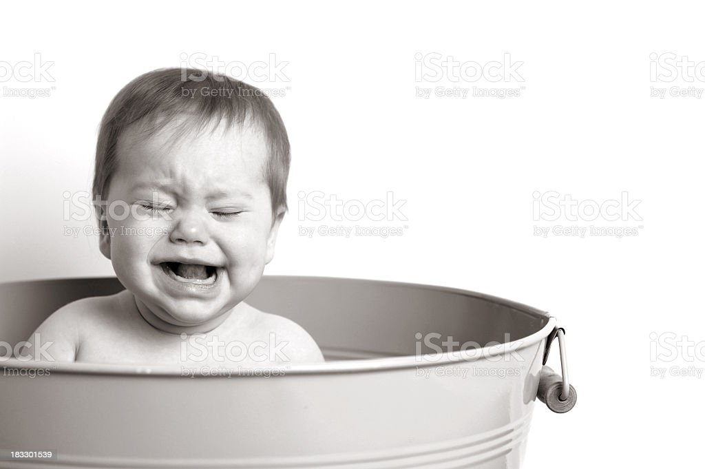 Black and White Image of Baby Crying in Metal Tub royalty-free stock photo