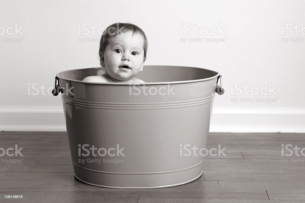 Black and White Image of Baby Sitting Metal Wash Tub, stock photo