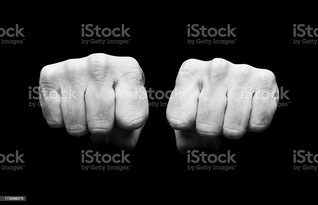 Black and white image of clenched fists stock photo