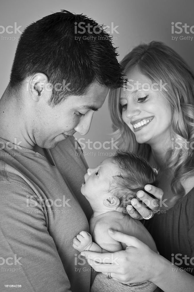 Black and White Image of Parents Adoring Their Newborn Son royalty-free stock photo