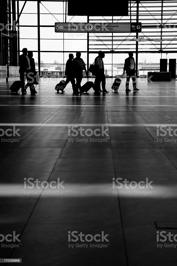 Black and white images of travelers in an airport royalty-free stock photo