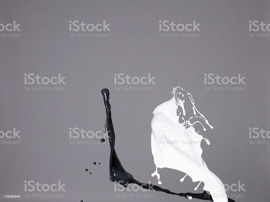 Black and white liquids splashing royalty-free stock photo