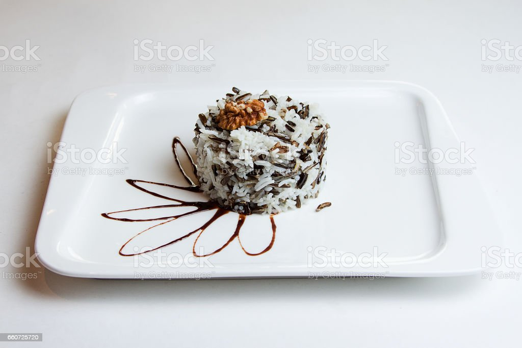 Black and white long-grain rice of cooked black & white rice in white ceramic bowl stock photo