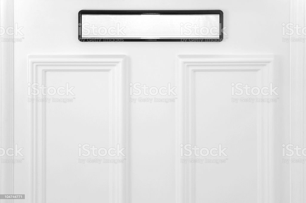 Black and white mail slot on a white door stock photo