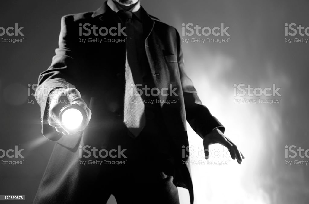 Black And White Man in Suit With Torch stock photo