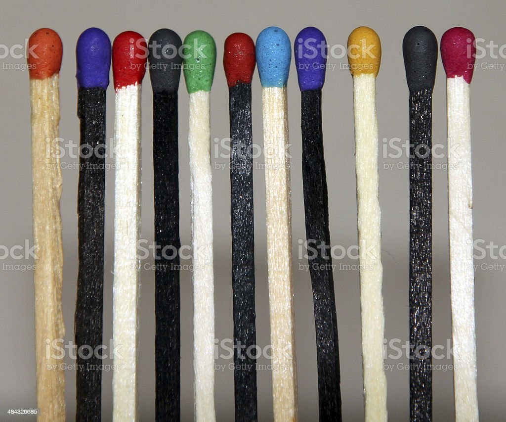 Black and white Match sticks with colored heads stock photo
