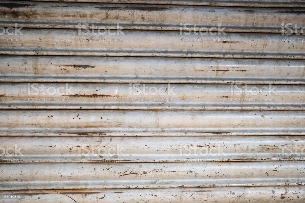 Black and white monochrome metal garage with stripes structure. Backgrounds and textures. Wall in Bangalore, Karnataka, India. stock photo