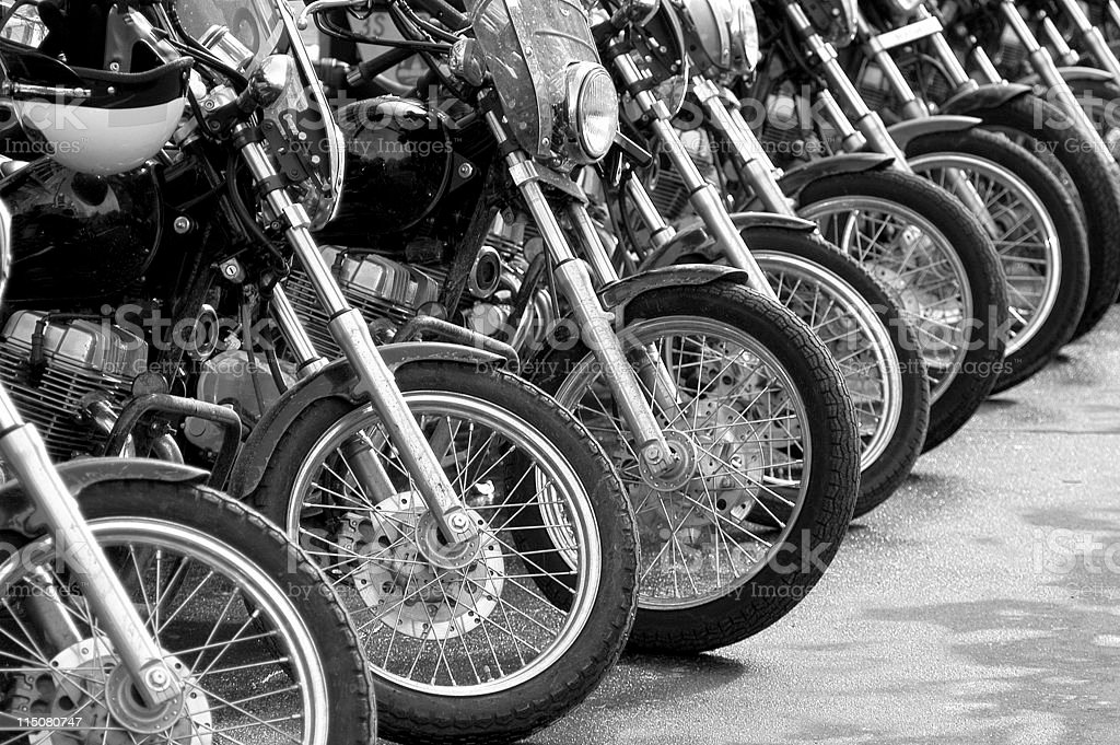 Black and white motorcycles lined up in a row stock photo