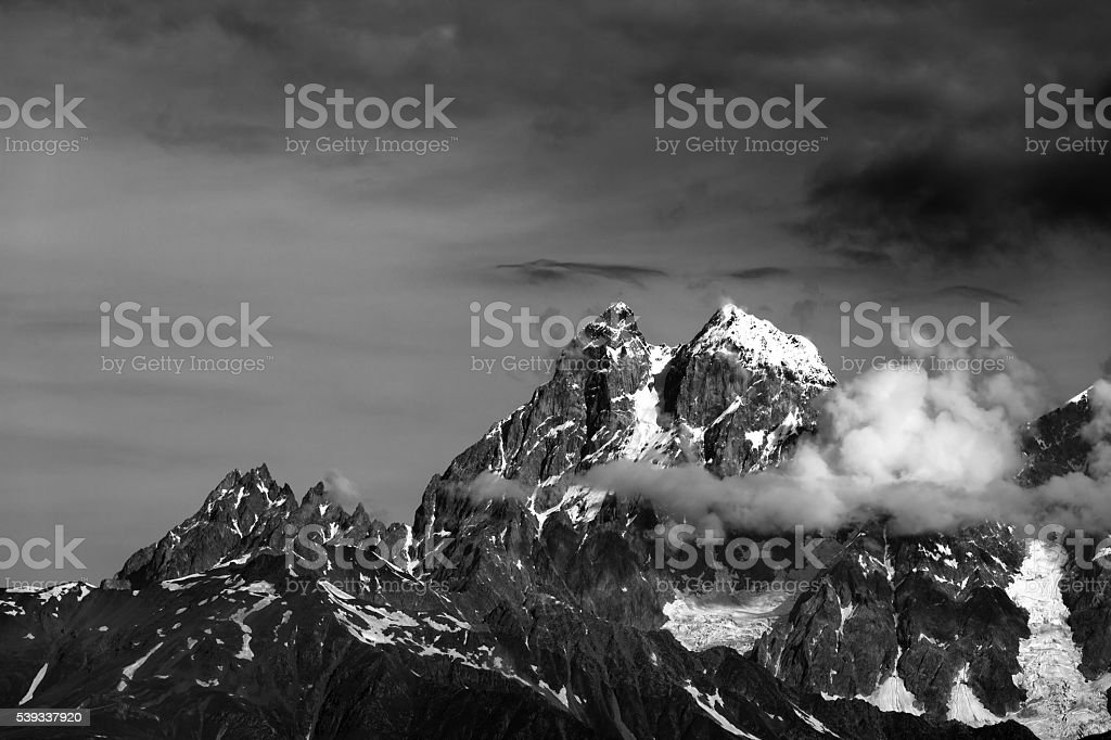 Black and white mountains in clouds stock photo