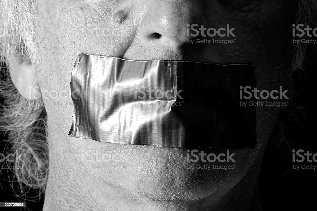 black and white mouth duct taped shut stock photo