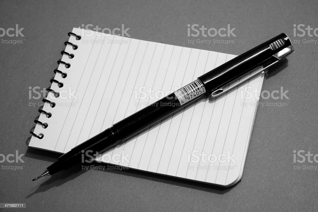 Black and White Notepad and Pen royalty-free stock photo