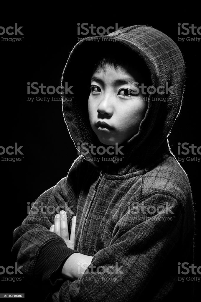 Black and White of Asian Boy in Hoodie stock photo