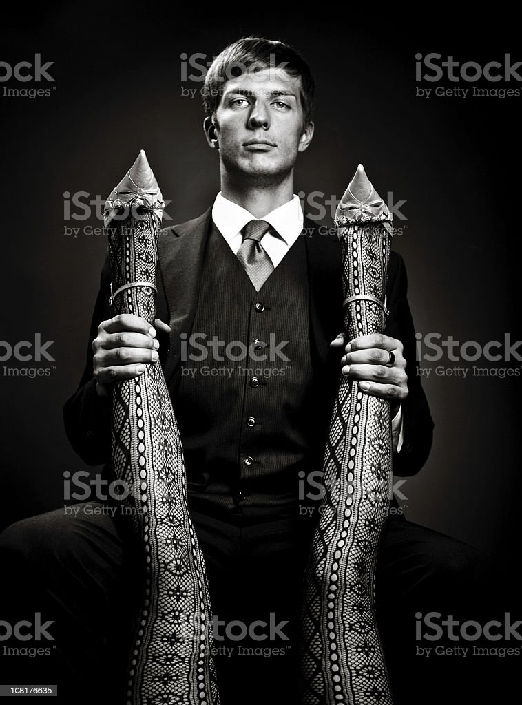 Black and White of Young Man Holding Woman's Legs royalty-free stock photo