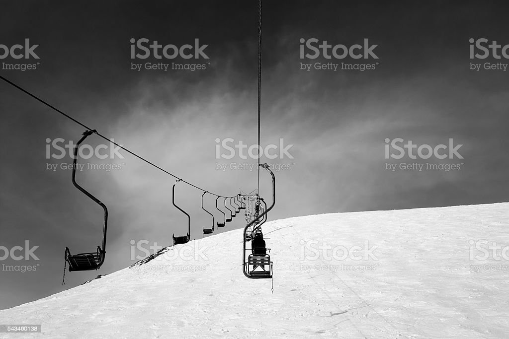 Black and white old chair-lift in ski resort stock photo