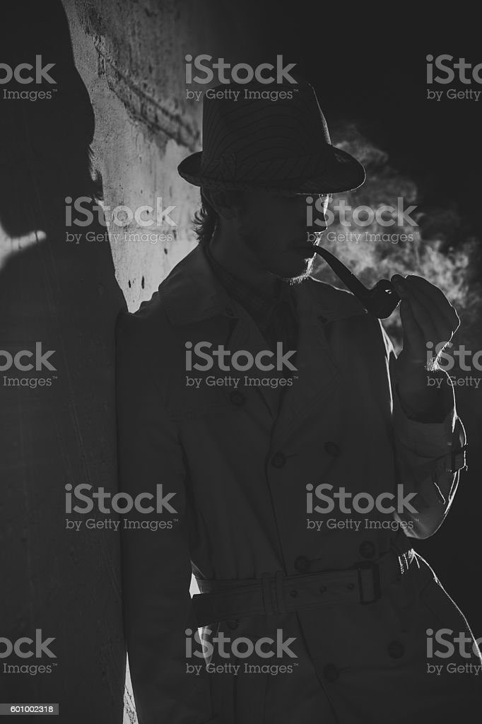 Black and white old-fashioned portrait of smiling man with cigar stock photo