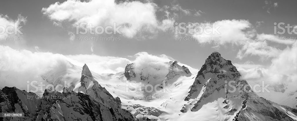 Black and white panorama mountains in cloud stock photo