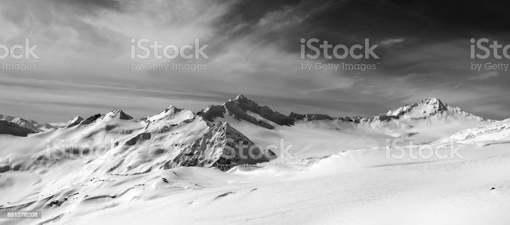 Black and white panorama of snow mountains in winter evening stock photo