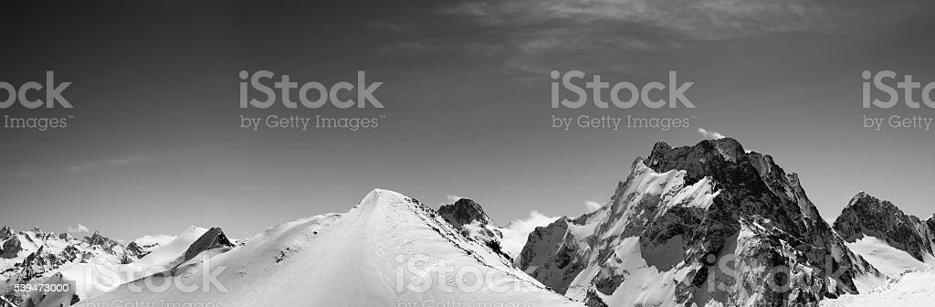 Black and white panorama of snowy mountains stock photo