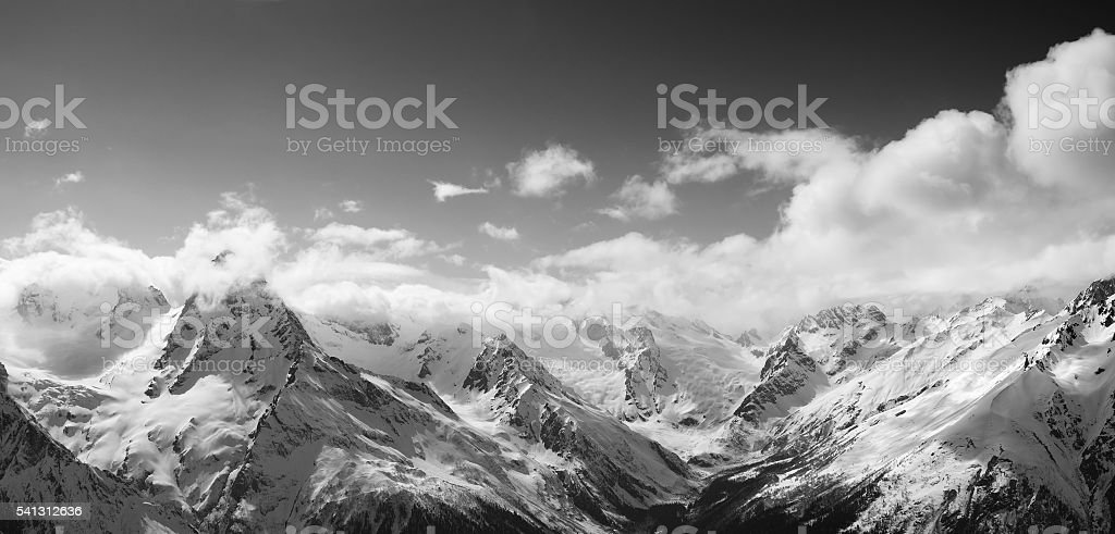 Black and white panorama of sunlight mountains in cloud stock photo