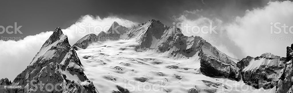 Black and white panorama of winter mountains stock photo