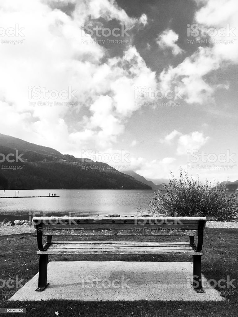 Black and white park bench and lake royalty-free stock photo