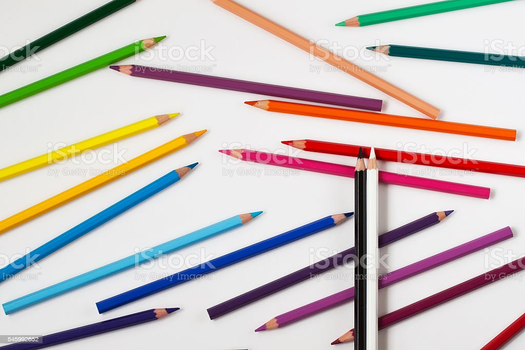 Black and white pencils top of the crayons stock photo