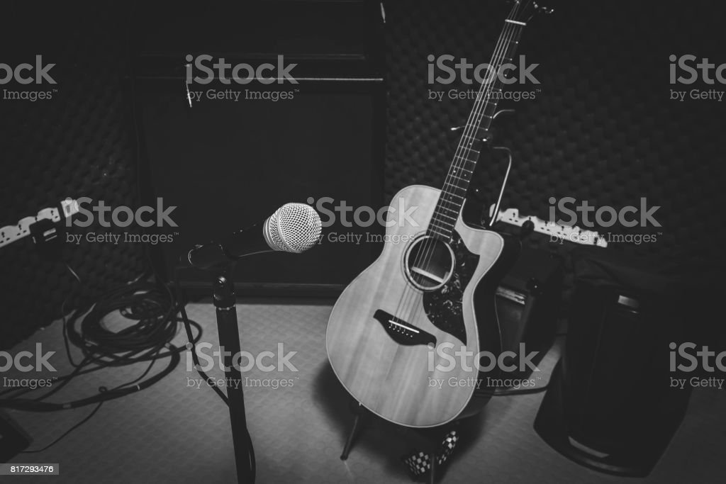 Black and White photo concept.the music band in the studio recording with Instrument is microphone classic guitar and speaker for live concert background. stock photo