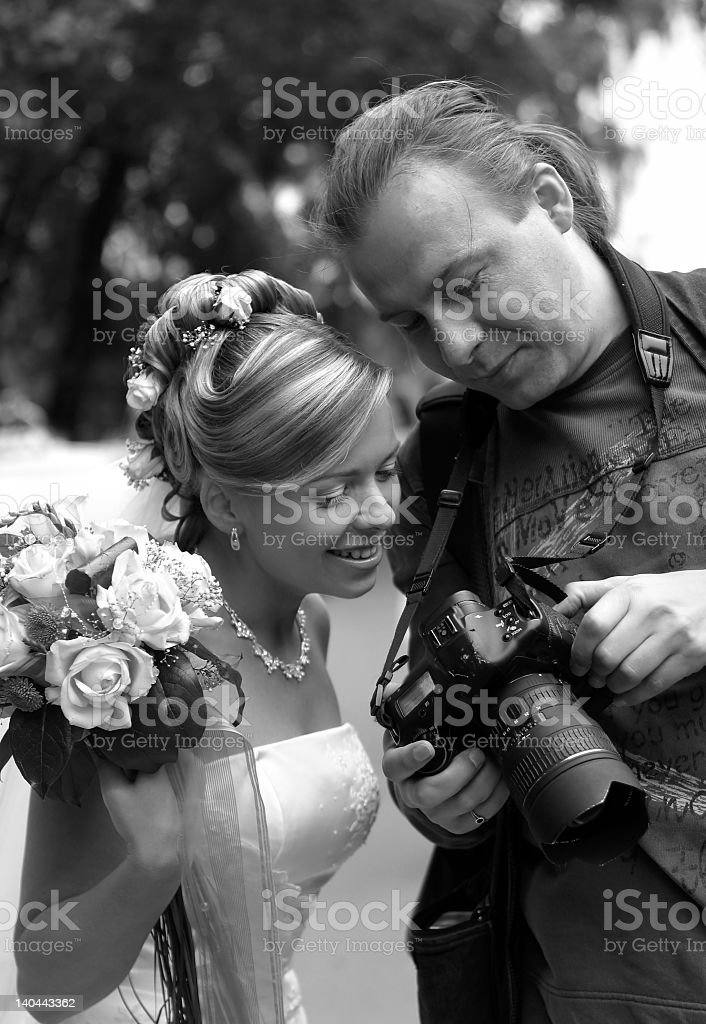 A black and white photo of a bride and wedding photographer royalty-free stock photo