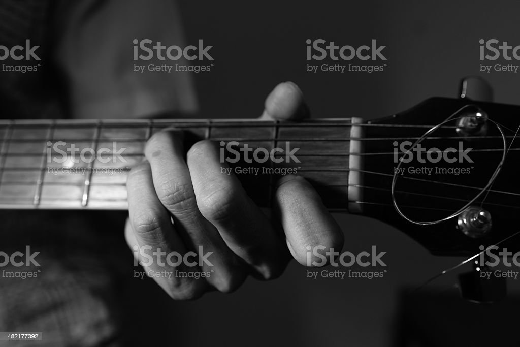 Black and White Photo of A Guy Playing Guitar stock photo