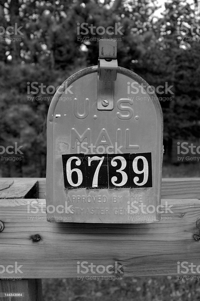 Black and white photo of a mail box with number 6739 stock photo